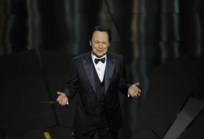 Host Billy Crystal speaks onstage during the 84th Academy Awards on Sunday, Feb. 26, 2012, in the Hollywood section of Los Angeles. (AP Photo/Mark J. Terrill)