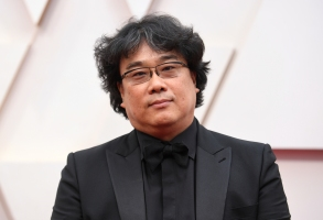 "FILE - Bong Joon-ho arrives at the Oscars on Sunday, Feb. 9, 2020, in Los Angeles. The ""Parasite"" director has been selected as jury president of the 78th Venice International Film Festival, organizers said Friday. The Oscar-winner will preside over seven jurors to hand out the festival's top awards, including the prestigious Golden Lion. (Photo by Richard Shotwell/Invision/AP, File)"