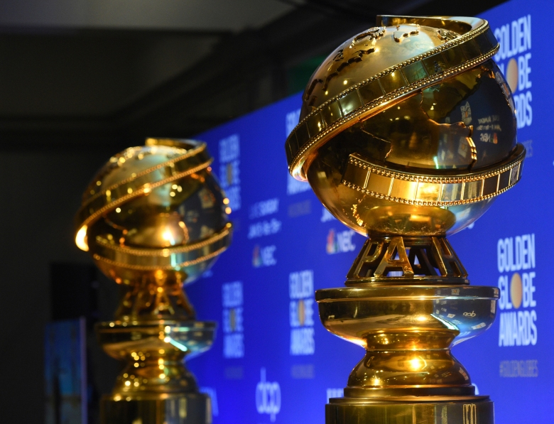 """FILE - This Dec. 9, 2019 file photo shows replicas of Golden Globe statues in Beverly Hills, Calif. Facing heightened scrutiny arounds its membership and practices, the group behind the Golden Globe Awards says that it is committed to immediate """"transformational change"""" and reforms. The Hollywood Foreign Press Association said in a statement Saturday, March 6, 2021, that it would focus on adding Black and other underrepresented members to its organization in addition to increasing transparency around its operations. (AP Photo/Chris Pizzello, File)"""