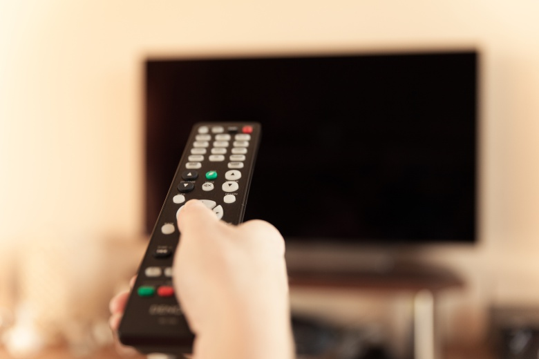 remote control of the TV in action