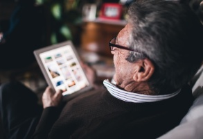 Old man using tablet