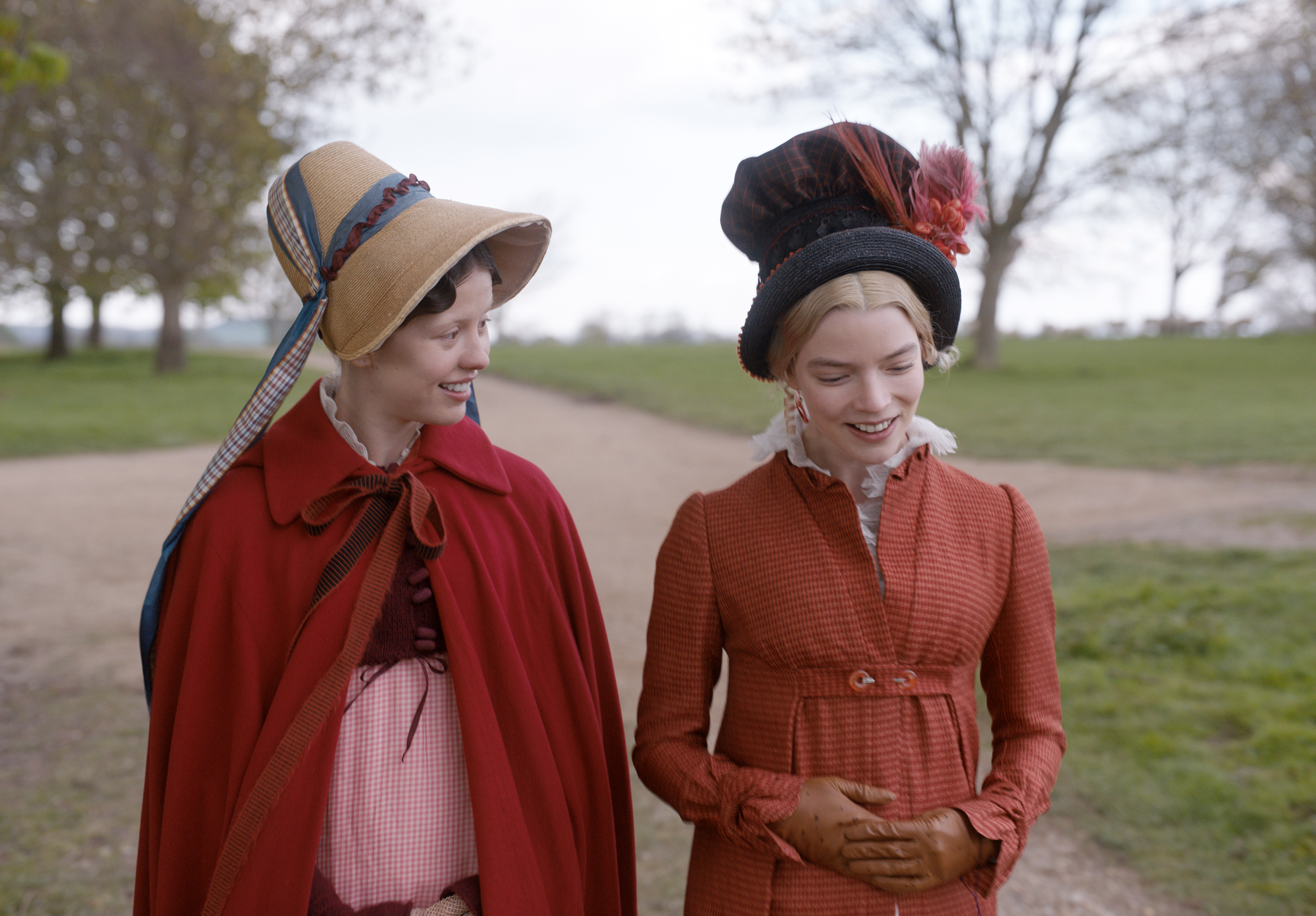 "Mia Goth (left) as ""Harriet Smith"" and Anya Taylor-Joy (right) as ""Emma Woodhouse"" in director Autumn de Wilde's EMMA, a Focus Features release. Credit : Focus Features"