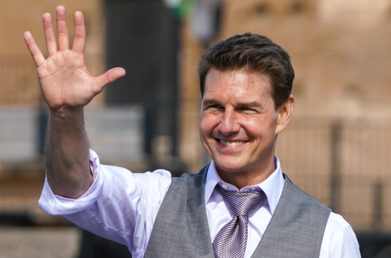 Tom Cruise waves to fans during a break in the shooting of the film Mission Impossible 7,
