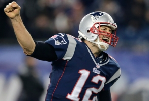 New England Patriots quarterback Tom Brady (12) reacts after a touchdown against the Indianapolis Colts in the fourth quarter of an NFL football game at Gillette Stadium in Foxborough, Mass., Sunday, Nov. 18, 2012. (AP Photo/Charles Krupa)