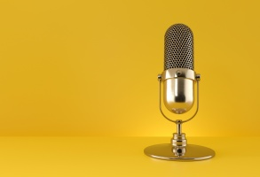 Creator content. Gold microphone on yellow background. 3d rendering.