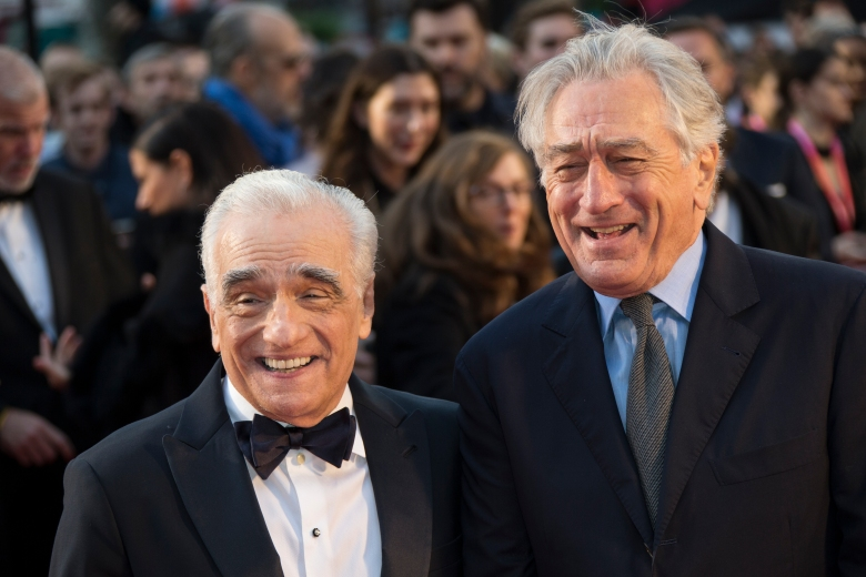 Director Martin Scorsese, left and actor Robert De Niro laugh as they pose for photographers upon arrival at the premiere of the film 'The Irishman' as part of the London Film Festival, in central London, Sunday, Oct. 13, 2019. (Photo by Joel C Ryan/Invision/AP)
