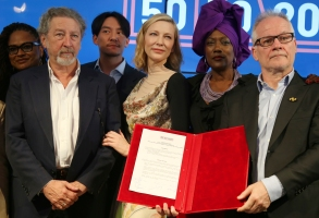 Jury members Ava DuVernay, from left, Robert Guediguian, Chang Chen, Cate Blanchett, Khadja Nin and Cannes Film Festival Director Thierry Fremaux pose for photographers with the 50/50 2020 Gender Equality Pledge during the 71st international film festival, Cannes, southern France, Monday, May 14, 2018. The pledge promises to make the selection process more transparent and push executive boards toward parity. (Photo by Joel C Ryan/Invision/AP)