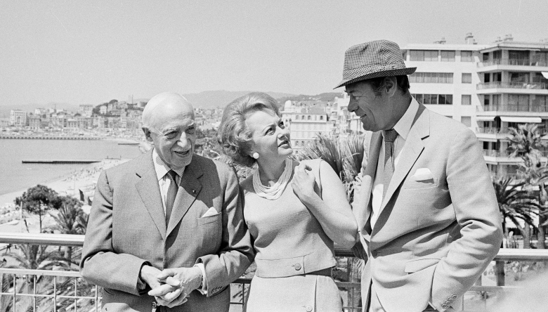 Film festival jury members Andre Maurois, Olivia de Havilland and Rex Harrison pose on the roof of the festival hall at Cannes, France, May 13, 1965. (AP Photo/Jean-Jacques Levy)
