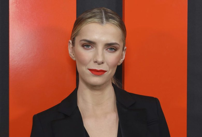 """Betty Gilpin arrives at the LA Special Screening of """"The Hunt"""" at the ArcLight Hollywood on Monday, March 9, 2020 in Los Angeles. (Photo by Willy Sanjuan/Invision/AP)"""