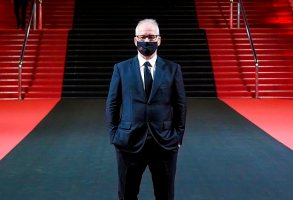 """Thierry Fremaux poses in front of the Palais des festival after the Best Short Film Palme D'Or Award Ceremony of the """"Special Cannes 2020 : Le Festival Revient Sur La Croisette !"""" as part of the Cannes Film Festival at Palais des Festivals on October 29, 2020 in Cannes, France. (Sipa via AP Images)"""