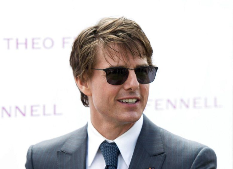 Photo by: DJ/AAD/STAR MAX/IPx 2021 5/10/21 Tom Cruise returns all 3 of his Golden Globe Trophies amid HFPA controversy. STAR MAX File Photo: 7/31/14 Tom Cruise at Ladies Day at the Glorious Goodwood Horse Races. (Chichester, West Sussex, England)