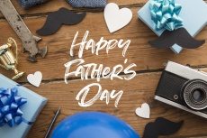 Happy Father's Day background concept with presents, mustache and trophy