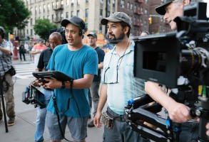 IN THE HEIGHTS, from left: director Jon M. Chu, Lin-Manuel Miranda, on set, 2021.  ph: Macall Polay /© Warner Bros. / courtesy Everett Collection
