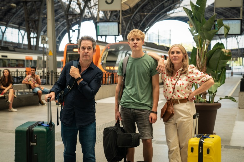 """MASTERPIECE""""Us""""Sundays, June 20 & 27, 2021 at 9/8cIn a drama tinged with humor and heartbreak, Tom Hollander (Baptiste, The Night Manager) and Saskia Reeves (Luther) play a couple who embark on a long-planned grand tour of Europe, despite the wife's wrenching proclamation that she wants to leave the marriage. The four-part series is based on a novel by best-selling author David Nicholls. The Daily Telegraph called it a """"brilliantly witty and heartfelt drama about a family on the edge.""""Shown from left to right: Tom Hollander as Douglas, Tom Taylor as Albie and Saskia Reeves as ConnieFor editorial use only.Courtesy of Drama Republic and MASTERPIECE."""