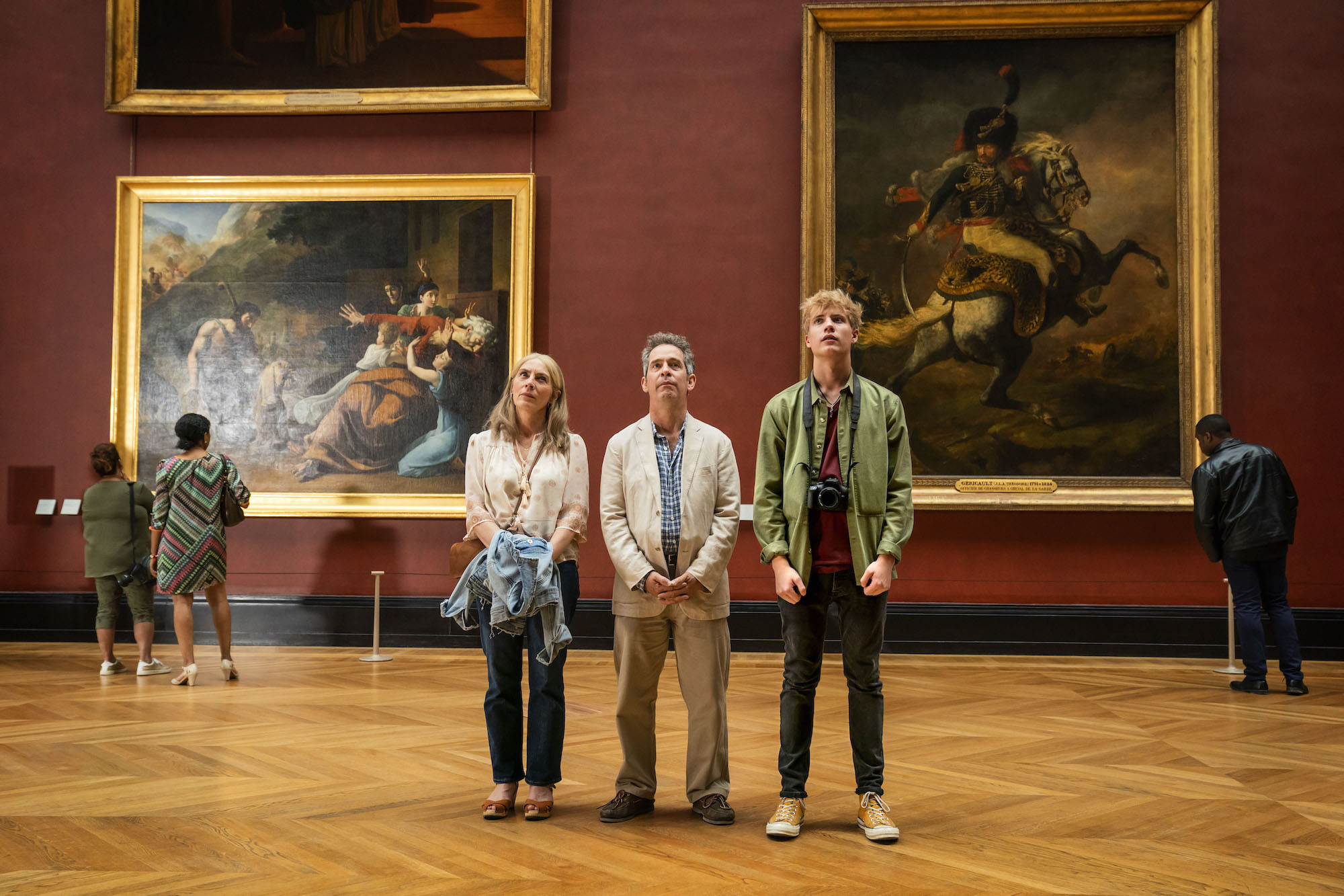 """MASTERPIECE""""Us""""Sundays, June 20 & 27, 2021 at 9/8cIn a drama tinged with humor and heartbreak, Tom Hollander (Baptiste, The Night Manager) and Saskia Reeves (Luther) play a couple who embark on a long-planned grand tour of Europe, despite the wife's wrenching proclamation that she wants to leave the marriage. The four-part series is based on a novel by best-selling author David Nicholls. The Daily Telegraph called it a """"brilliantly witty and heartfelt drama about a family on the edge.""""Shown from left to right: Saskia Reeves as Connie, Tom Hollander as Douglas and Tom Taylor as AlbieFor editorial use only.Courtesy of Drama Republic and MASTERPIECE."""