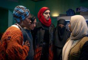 "WE ARE LADY PARTS -- ""Play Something"", Episode 101 -- Pictured: (l-r)  Faith Omole as Bisma, Sarah Kameela Impey as Saira, Juliette Motamed as Ayesha, Lucie Shorthouse as Momtaz, Anjana Vasan as Amina -- (Photo by: Saima Khalid/Peacock)"