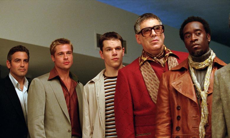 "George Clooney, Brad Pitt, Matt Damon, Elliott Gould, and Don Cheadle in ""Ocean's Eleven"""