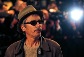 Director Leos Carax arrives for the screening of The Great Beauty at the 66th international film festival, in Cannes, southern France, Tuesday, May 21, 2013. (AP Photo/Francois Mori)