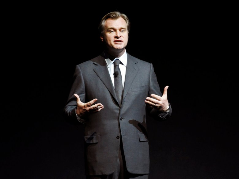 """FILE - In this March 29, 2017 file photo, Christopher Nolan, director of the upcoming film """"Dunkirk,"""" discusses the film during the Warner Bros. Pictures presentation at CinemaCon 2017 in Las Vegas. (Photo by Chris Pizzello/Invision/AP, File)"""