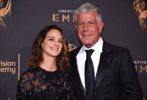 Asia Argento, left, and Anthony Bourdain arrive at night one of the Television Academy's 2017 Creative Arts Emmy Awards at the Microsoft Theater on Saturday, Sept. 9, 2017, in Los Angeles. (Photo by Phil McCarten/Invision for the Television Academy/AP Images)