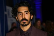 Dev Patel poses for photographers upon arrival at the British Independent Film Awards in central London, Sunday, Dec. 1, 2019. (Photo by Joel C Ryan/Invision/AP)