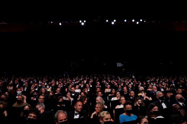 members of the audience are seen at the opening ceremony of the 74th international film festival, Cannes, southern France, Tuesday, July 6, 2021. (Photo by Vianney Le Caer/Invision/AP)