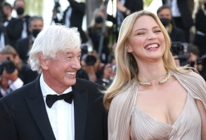 Paul Verhoeven, left, and Virginie Efira pose for photographers upon arrival at the premiere of the film 'Benedetta' at the 74th international film festival, Cannes, southern France, Friday, July 9, 2021. (Photo by Vianney Le Caer/Invision/AP)