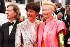 Director Wes Anderson, from left, Timothee Chalamet, and Tilda Swinton pose for photographers upon arrival at the premiere of the film 'The French Dispatch' at the 74th international film festival, Cannes, southern France, Monday, July 12, 2021. (AP Photo/Brynn Anderson)