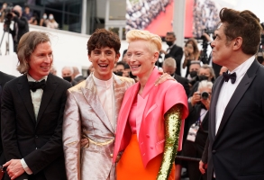 Director Wes Anderson, from left, Timothee Chalamet, Tilda Swinton, and Benicio Del Toro pose for photographers upon arrival at the premiere of the film 'The French Dispatch' at the 74th international film festival, Cannes, southern France, Monday, July 12, 2021. (AP Photo/Brynn Anderson)
