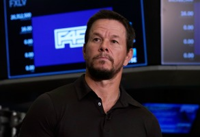 Actor Mark Wahlberg is interviewed on the floor of the New York Stock Exchange, Thursday, July 15, 2021. (AP Photo/Richard Drew)