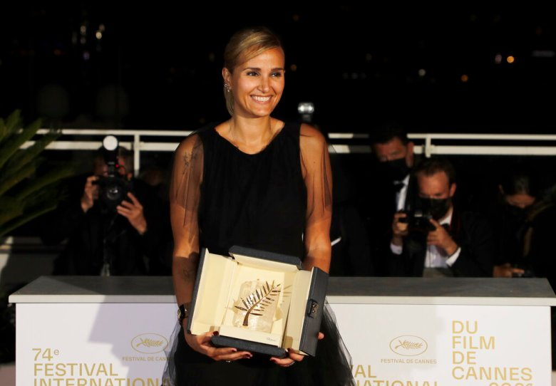 Director Julia Ducournau, winner of the Palme d'Or for the film 'Titane' poses for photographers during a photo call following the awards ceremony at the 74th international film festival, Cannes, southern France, Saturday, July 17, 2021. (Photo by Vianney Le Caer/Invision/AP)