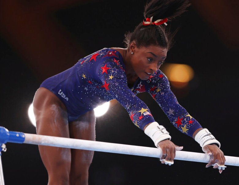 Simone Biles of United States takes part in Artistic Gymnastics women's qualification of Tokyo Olympic Games at Ariake Gymnastics Center in Tokyo on July 25, 2021. Simone Biles withdraws from Tokyo Olympics. ( The Yomiuri Shimbun via AP Images )
