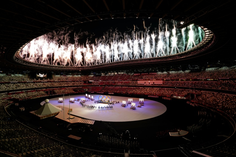 Fireworks explode during the opening ceremony in the Olympic Stadium at the 2020 Summer Olympics, Friday, July 23, 2021, in Tokyo, Japan. (AP Photo/Patrick Semansky)