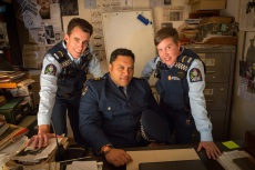Wellington Paranormal — Episode 1— Image Number: WPN101_0005.jpg — Pictured (L-R):  Minogue, Sergeant Maaka and O'Leary in the Wellington Paranormal office. Photo: Stan Alley/The CW —©2021 The CW Network, LLC. All Rights Reserved.