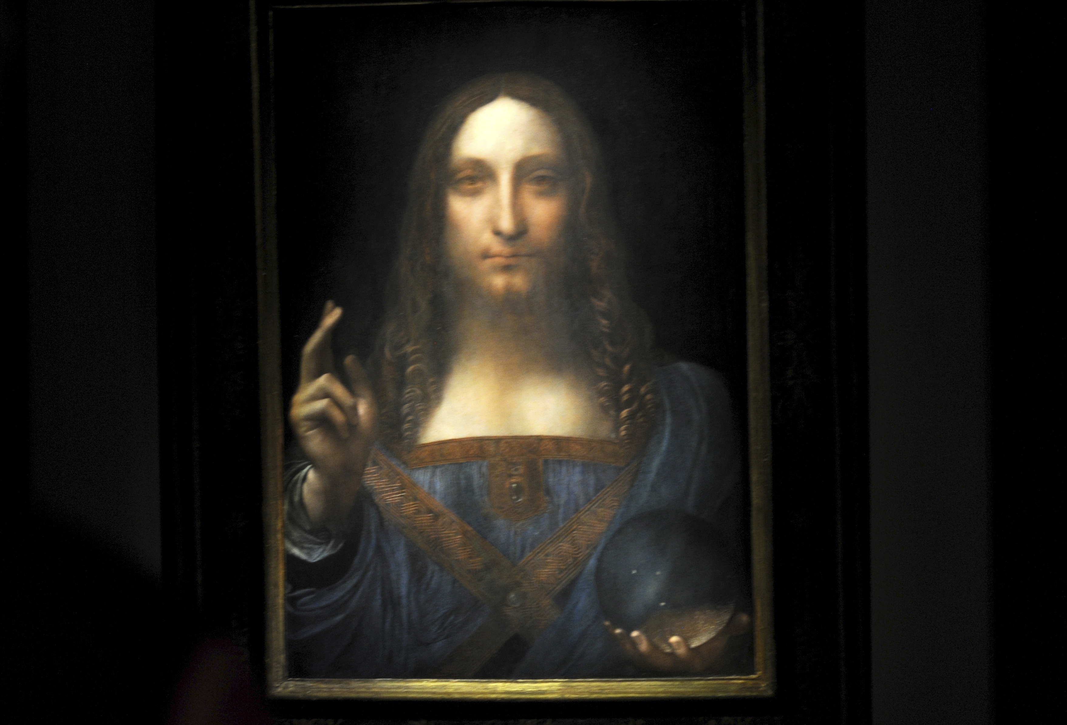 Leonardo da Vinci's Salvator Mundi painting is on display at a press preview at Christie's in New York City, NY, USA, on November 3, 2017. Leonardo's Salvator Mundi, one of fewer than 20 surviving paintings accepted as from the artist's own hand, has caused a worldwide media sensation and will be auctioned off at an estimated price of 100 Million dollars next week in New York. Photo by Dennis Van Tine/Sipa USA(Sipa via AP Images)