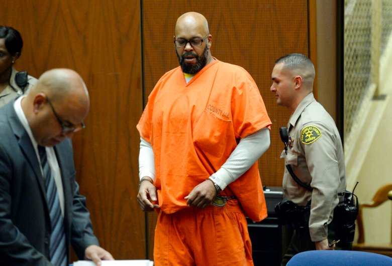 """Marion """"Suge"""" Knight is escorted into for during his arraignment on murder charges in Los Angeles Thursday, April 30, 2015. Los Angeles Superior Court Judge Ronald Coen set a July 7, 2015 trial date for the murder case against Knight that was filed after the former rap music mogul ran over two men earlier this year. Knight pleaded not guilty to murder, attempted murder and hit-and-run charges filed after he killed one man and seriously injured another with his pickup outside a Compton, Calif., burger stand in January. (Kevork Djansezian/Pool Photo via AP)"""