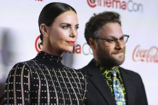 LAS VEGAS, NEVADA, USA - APRIL 04: Actress Charlize Theron and actor Seth Rogen arrive at the CinemaCon Big Screen Achievement Awards 2019 held at Omnia Nightclub at Caesars Palace during CinemaCon, the official convention of the National Association of Theatre Owners on April 4, 2019 in Las Vegas, Nevada, United States. (Photo by Xavier Collin/Image Press Agency/Sipa USA)(Sipa via AP Images)