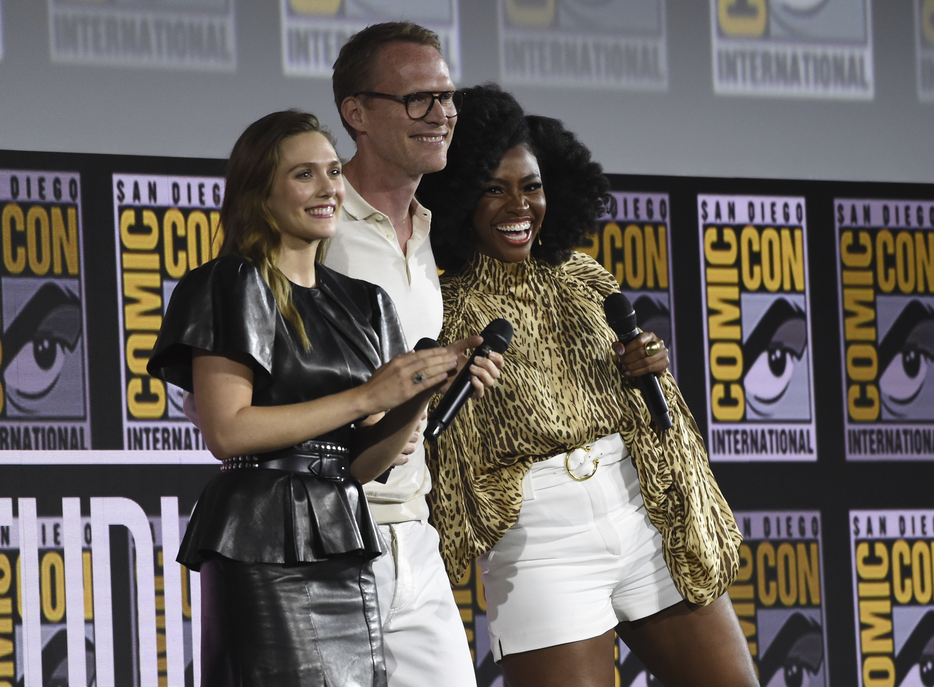 """Elizabeth Olsen, from left, Paul Bettany and Teyonah Parris participate in the """"WandaVision"""" portion of the Marvel Studios panel on day three of Comic-Con International on Saturday, July 20, 2019, in San Diego. (Photo by Chris Pizzello/Invision/AP)"""