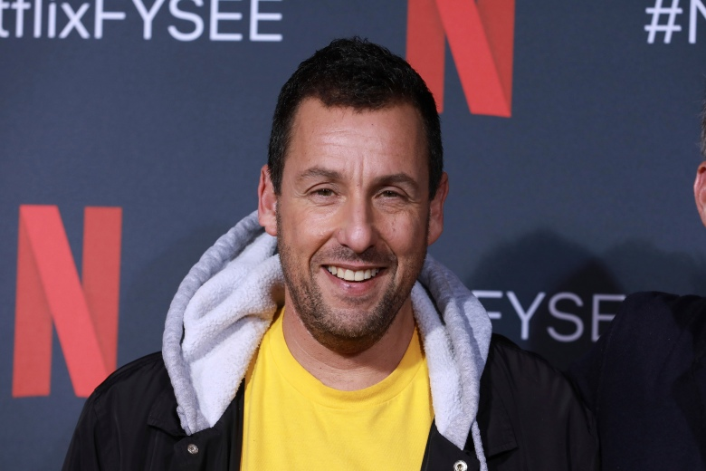 """FILE - This May 29, 2019 file photo shows Adam Sandler at the """"Adam Sandler: 100% Fresh"""" FYC event in Los Angeles. Netflix  announced Friday that Sandler and his Happy Madison Productions have reached a new deal with them to make four more films. He's had five films with the studio along with the stand-up special """"Adam Sandler: 100% Fresh.""""   (Photo by Mark Von Holden/Invision/AP, File)"""
