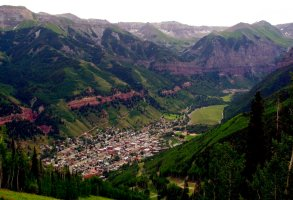 FILE - In this July 17, 2001, file photo, a view of Telluride, Colo. appears nestled in a valley from the top of Mount St. Sophia. The Telluride Film Festival, the annual film retreat held in the Colorado mountains and one of the fall movie season's top launching pads, has been canceled. Festival organizers said Tuesday that its 47th edition, scheduled for Labor Day weekend, has been scuttled entirely due to the coronavirus pandemic. (AP Photo/Ed Andrieski/File)