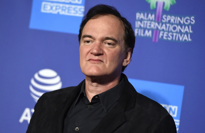 """FILE - Quentin Tarantino arrives at the 31st annual Palm Springs International Film Festival Awards Gala on Jan. 2, 2020, in Palm Springs, Calif. The Oscar-winning director has a two-book deal with Harper, beginning with a novelization of """"Once Upon a Time ... In Hollywood"""" that is scheduled for next summer. (Photo by Jordan Strauss/Invision/AP, File)"""