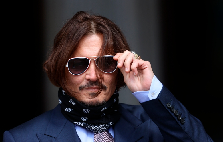 """Johnny Depp court case. File photo dated 17/07/20 of actor Johnny Depp, whose bid to overturn a damning ruling that he assaulted his ex-wife Amber Heard and put her in fear for her life will by consider by the Court of Appeal on Thursday. Issue date: Thursday March 18, 2021. The Hollywood star wants the court to order a retrial of his libel claim against The Sun over an article calling him a """"wife beater"""", which a High Court judge found was """"substantially true"""".See PA story COURTS Depp. Photo credit should read: Yui Mok/PA Wire URN:58671418 (Press Association via AP Images)"""