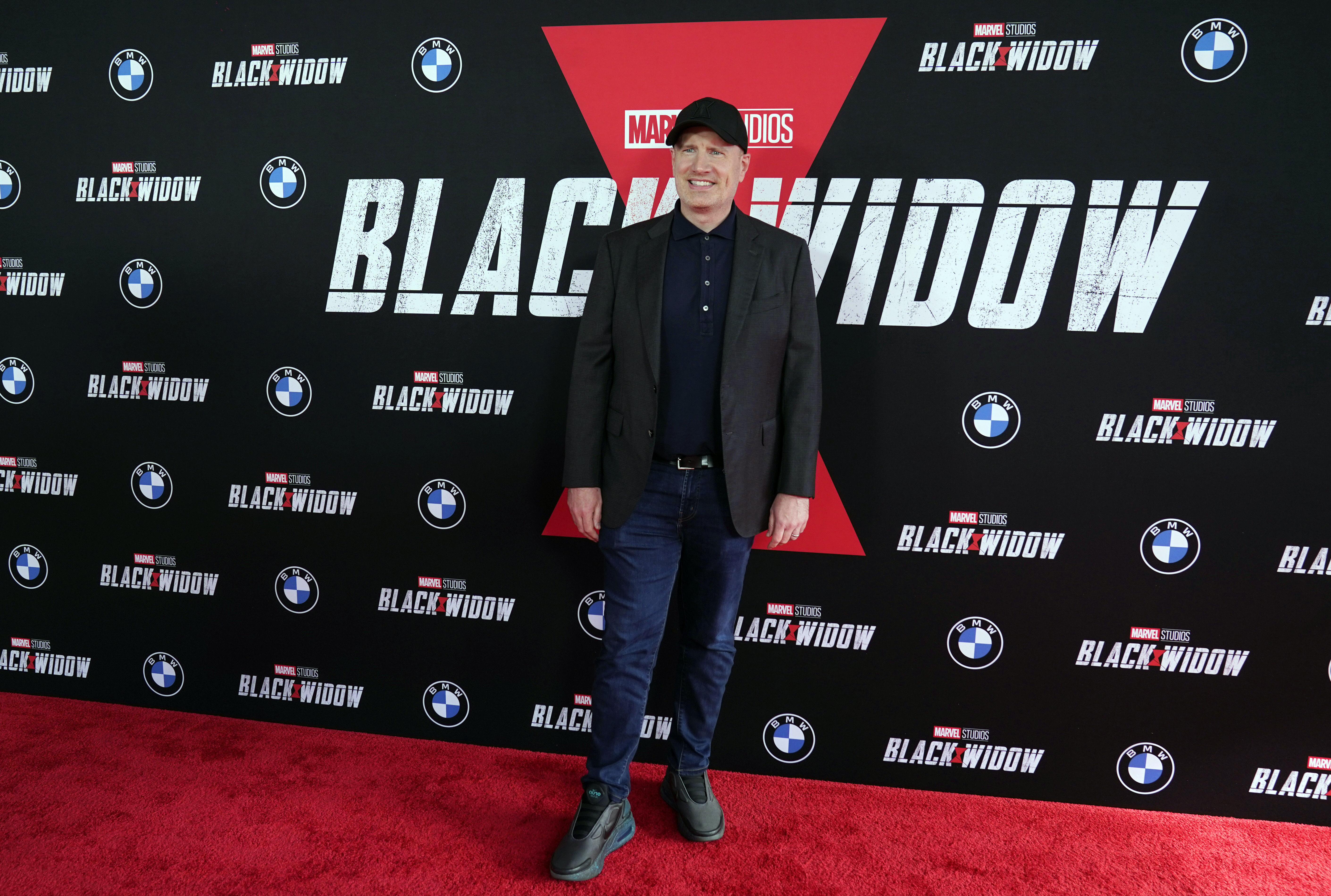 """Kevin Feige, chief creative officer and president of Marvel Studios, poses before a fan screening of the new Marvel film """"Black Widow"""" at the El Capitan Theatre, Tuesday, June 29, 2021, in Los Angeles. (AP Photo/Chris Pizzello)"""
