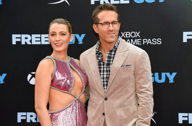 """Actor Ryan Reynolds, right, and wife Blake Lively attend the world premiere of """"Free Guy"""" at AMC Lincoln Square 13 on Tuesday, Aug. 3, 2021, in New York. (Photo by Evan Agostini/Invision/AP)"""