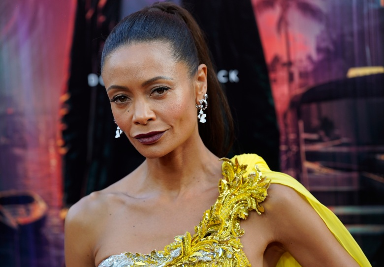 """Thandiwe Newton, a cast member in """"Reminiscence,"""" poses at the premiere of the film, Tuesday, Aug. 17, 2021, at the TCL Chinese Theatre in Los Angeles. (AP Photo/Chris Pizzello)"""
