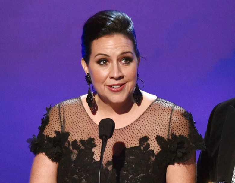 """FILE - In this Feb. 8, 2015 file photo, Kristen Anderson-Lopez accepts the award for best song written for visual media for """"Let It Go"""" at the 57th annual Grammy Awards in Los Angeles. (Photo by John Shearer/Invision/AP, File)"""