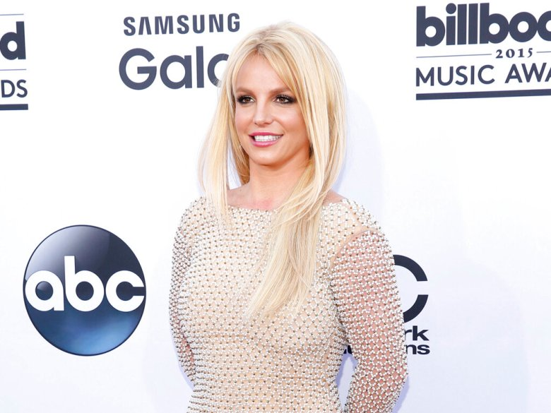 FILE - In this May 17, 2015 file photo, Britney Spears arrives at the Billboard Music Awards in Las Vegas. Spears will open the Billboard Music Awards with a 7-minute medley on Sunday, May 22, 2016. (Photo by Eric Jamison/Invision/AP, File)