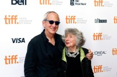 """Producer Michael Shamberg and executive producer Marcia Nasatir pose for photographs as they arrive at the 30th anniversary gala for the movie """"The Big Chill"""" during the 2013 Toronto International Film Festival in Toronto on Thursday, Sept. 5, 2013. (AP Photo/The Canadian Press, Galit Rodan)"""