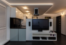 Minimalist apartment - living room with a view at kitchen