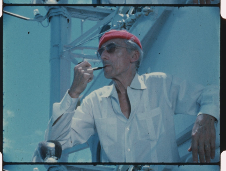Jacques Cousteau wears his iconic red diving cap aboard his ship Calypso, circa 1970s. (Credit: The Cousteau Society)